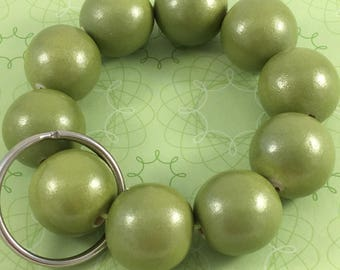 Green wooden bead bracelet keychain