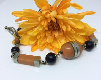 Art deco modernist design necklace with coral coloured Bakelite or Galalith beads