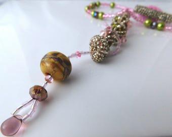 OOAK Swirl and twirl pendant in shining pink with lamp work bead.