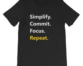Simplify. Commit. Focus. Repeat. Short-Sleeve Unisex T-Shirt