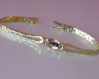 18k gold bracelet and natural blue sapphires