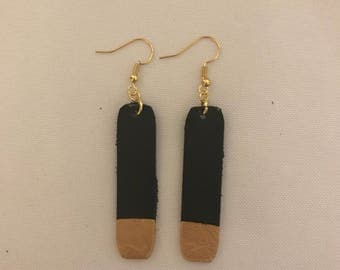 Black and gold tipped earrings