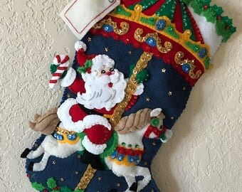 """Brand new completed felt stocking """"Christmas Carousel"""" by Bucilla"""
