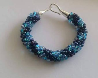 Bracelet made by Kumihimo braiding with drop beads