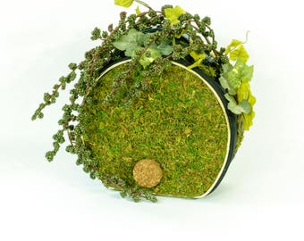 Moss-covered handbag with artificial champage grape vine