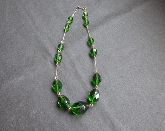 A green glass bead necklace
