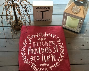 Somewhere Between Proverbs 31 & Tupac There's me/ Women's T-Shirts