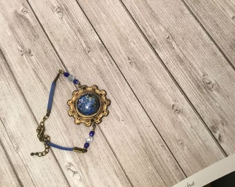 Bronze cameo bracelet with blue stone