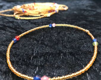Hand made african glass bead anklet, with brass clasp. Each piece is unique and individual