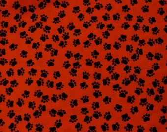 "1/2 YD - 46"" Red W/ Black Paw Print Cotton Fabric"