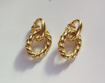 Yves Saint-Laurent earrings marked YSL