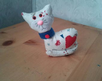 Cat in nautical cotton print. Anchors, crabs, sailboats. Hypoallergenic stuffing. Safety eyes n nose. Velcro collar. Measures 5 inches high.