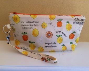 The Essential Zipper Wristlet- Lemons and Sour Faces
