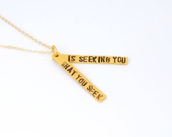 GOLD Vermeil Hand stamped inspirational quote necklace What You Seek Is Seeking You.  Handcrafted by Chocolate and Steel large font quote