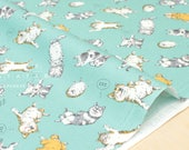 Japanese Fabric Kokka Laughing Shiba Inu, Hedgehog, Cat - mint blue - fat quarter