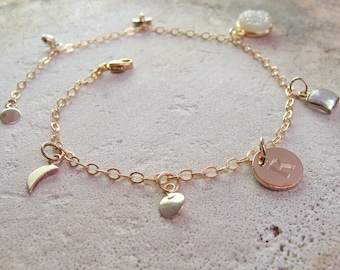 delicate gold Charm bracelet with celestial tiny stars and moons