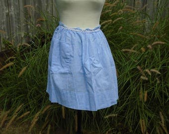2 vintage gingham aprons in shades of blue with pockets