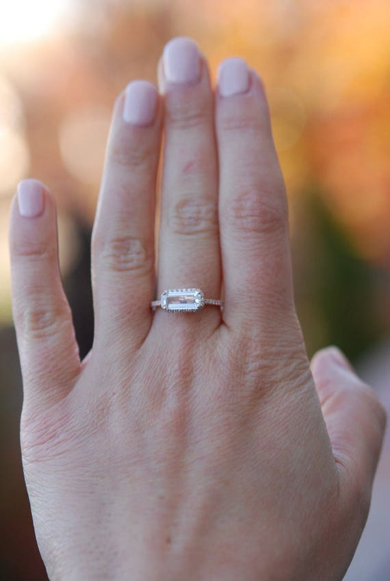 Baguette engagement ring. 1.9ct rectangular emerald cut white sapphire 14k rose gold diamond ring. Engagement ring by Eidelprecious.