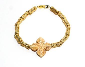 Gypsy boho carved bone flower and golden beaded stackable bracelet