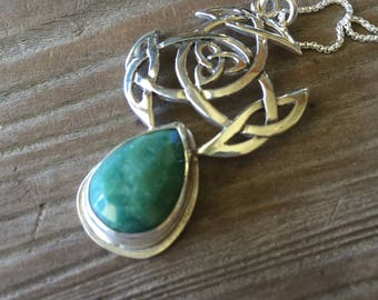 Celtic knotwork pendant with Emerald