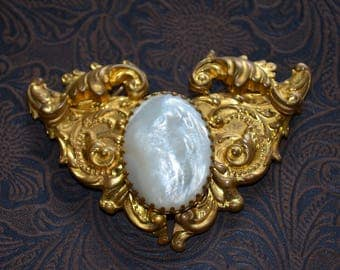 Vintage Antique belt buckle with pearlescent mother of pearl cabochon Gold scroll design.  for reenactment wear or design.