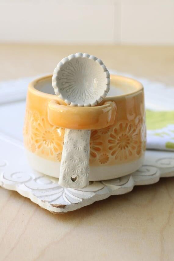 orange dip bowl with spoon