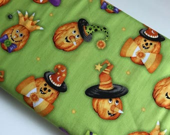 Happy Haunting Jack O Lanterns on Green - Henry Glass cotton woven fabric by the yard