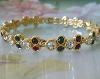 SALE Was 65.00 SWAROVSKI Swan SIGNED Bezel Set Crystal Multi-Colored Bubble Crystal Gold Link Bracelet