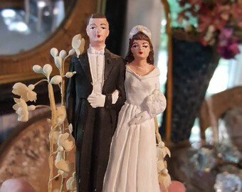 Vintage Chalkware Bride and Groom Cake Topper With Milinery Flowers from Rustysecrets