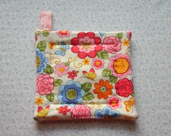 peach pink and blue spring flowers hand quilted insulated potholder with loop to hang