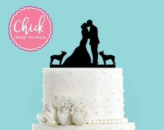 Couple Kissing with Two Boston Terriers Wedding Cake Topper