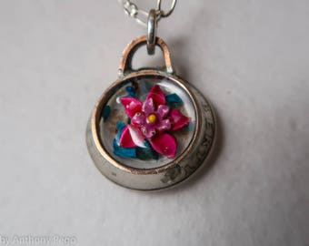 Vintage pink enamel flower set in hand-hammered 1987 US quarter, backed with turquoise shards and Oklahoma red dirt