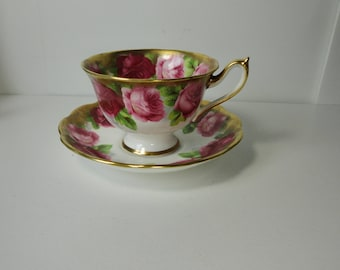 Royal Albert Bone China Light and Dark Roses over heavy Sponged Gold Cup and Saucer set. 1950s.
