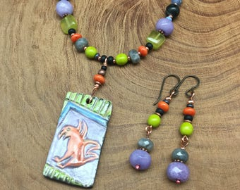Raku pendant with petroglyph bird and brightly colored beads and matching earrings