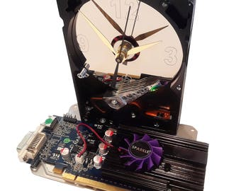 Hard Drive Clock has Rare Blue Graphics Circuit Board as the Base with Cooling Tower & Purple Fan Attached. Amazing Clock. Got Office Gift?