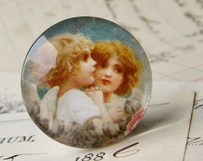 Angel embrace, handmade glass cabochon, round 25mm cabochon, 1 inch circle, Victorian vintage, angel wing, bottle cap, illustration