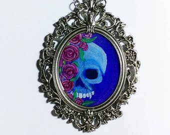 Hand painted skull and roses in ornate frame necklace. Dia de los muertos