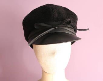 A black faux fur & leather Cap