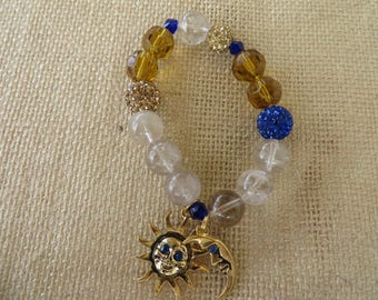 Stretchy Sun And Moon Gold Toned Charm And Rutilated Quartz Bead Bracelet