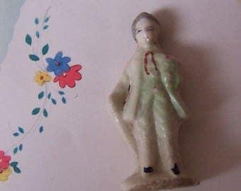 tiny antique porcelain figurine
