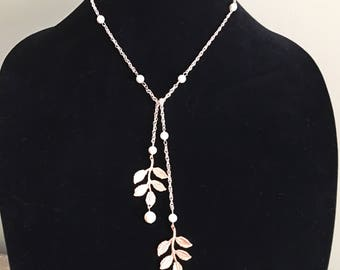 Rose Gold Backdrop Necklace with Swarovski pearls in  reamrose and a pretty leaf design blush wedding bridal jewelry