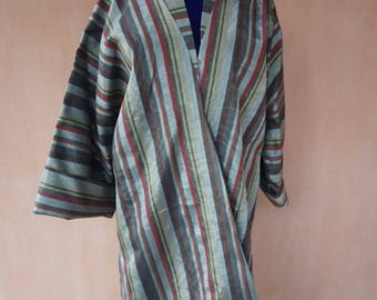 Uzbek traditional silk ikat long chapan. Bekhasam kaftan, tribal ethnic coat, silk stripe robe