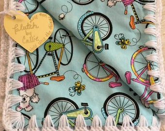 Puppy in a bicycle crochet edged flannel baby blanket