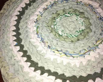 Green upcycled area rug