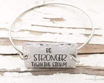 Hand stamped Be Stronger Than The Storm bangle bracelet inspirational jewelry affirmation jewelry