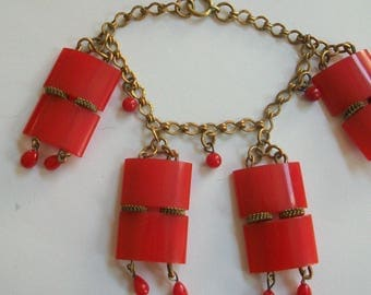 Vintage 1930s red bracelet, dangle, geometric, brass chain, unusual, different, 1930s era jewelry, red plastic charms, unique