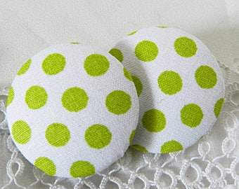 White fabric button with green polka dots, 32 mm in diameter