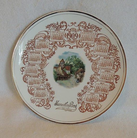 Vintage 1909 Calendar Plate American China Co.. Village Scene.. Shandeling Bros.