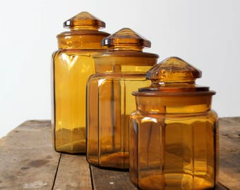 antique amber glass jars, faceted glass canisters