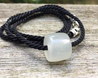 Hand Carved Gemmy White Hydrogrossular Garnet Bead on Black Silk Necklace